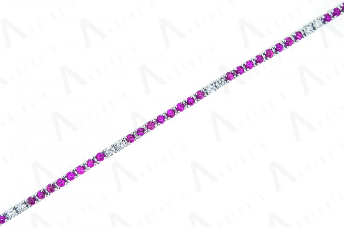 18 KARAT DIAMOND AND COLOR STONE BRACELET