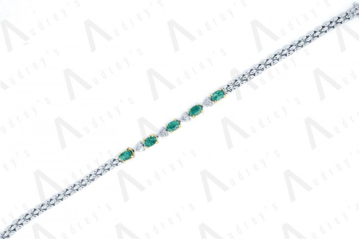 18 KARAT DIAMOND AND GEMSTONE BRACELET